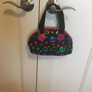 Little girls sparkly peace purse